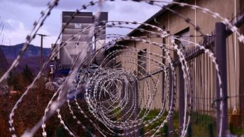 Image of barbed wire immigration detention camp